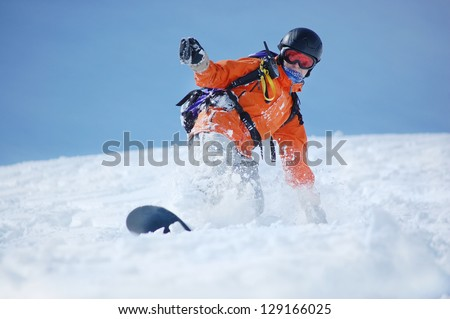 Snowboarder in action at the mountains - stock photo
