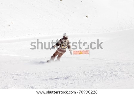 Snowboarder in action on snow mountain. Alps. France.