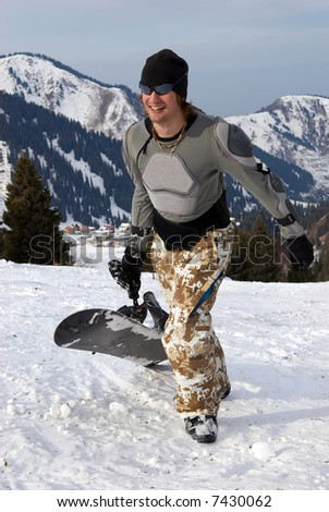 Snowboarder in defence on ski resort slope - stock photo