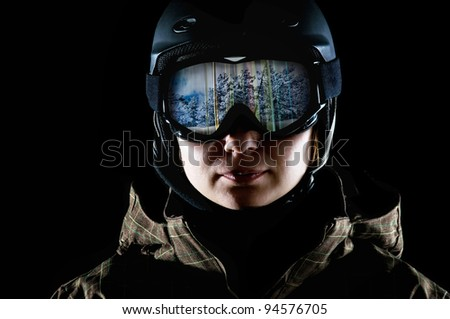 snowboarder in the mask and helmet on a black background - stock photo