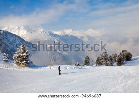 Snowboarder in the most famous winter resort Mayrhofen, Austria