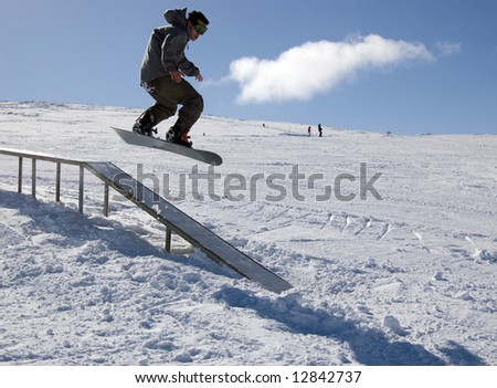 Snowboarder in the park - stock photo
