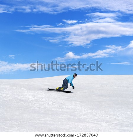 Snowboarder in winter mountains at nice sun day - stock photo