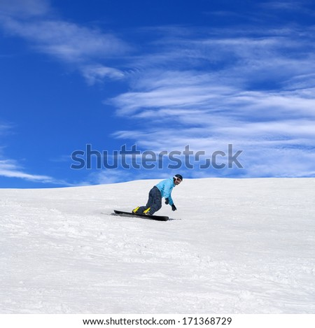 Snowboarder in winter mountains at nice sunny day - stock photo
