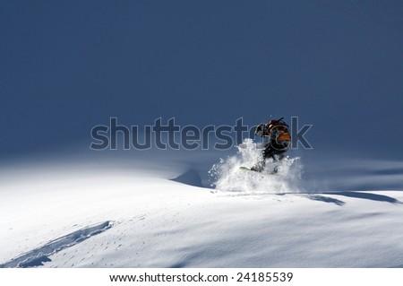 Snowboarder jump in powder - stock photo