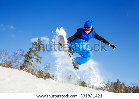 snowboarder jumping from the mountaint along the road extreme - stock photo
