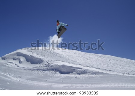 Snowboarder jumping in terrain park - stock photo