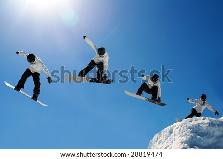 Snowboarder jumping through air - stock photo