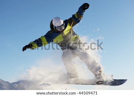 snowboarder jumps  against the sky - stock photo
