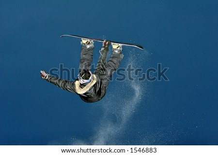 Snowboarder jumps and do some atractive tric. - stock photo