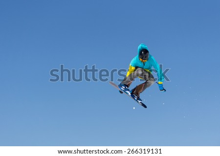 Snowboarder jumps in Snow Park, big air - stock photo