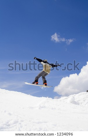 Snowboarder jumps in the air - professional