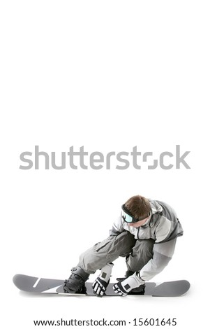 Snowboarder leaning backwards on board for speed, isolated - stock photo