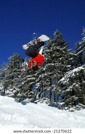 snowboarder make a flip - stock photo