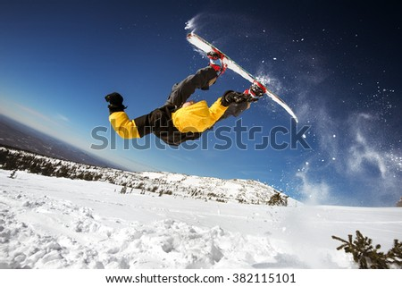 Snowboarder makes front flip. Sheregesh resort, Siberia, Russia