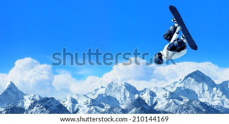 Snowboarder making high jump in clear blue sky - stock photo