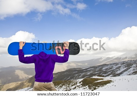 Snowboarder observing his new challenge - stock photo