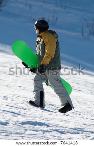 Snowboarder on ski slope - stock photo