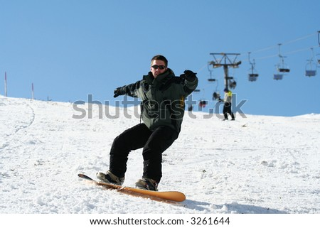 Snowboarder on snow. Winter resort in Alps - stock photo