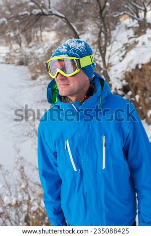 Snowboarder on the cliff - stock photo