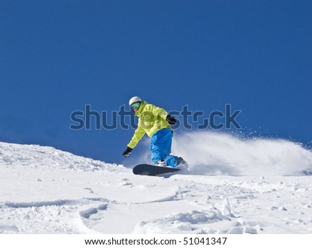 Snowboarder on the go - stock photo