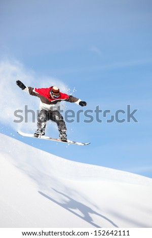 Snowboarder performing impressive jump - stock photo