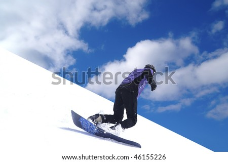 Snowboarder riding on ski slope - stock photo