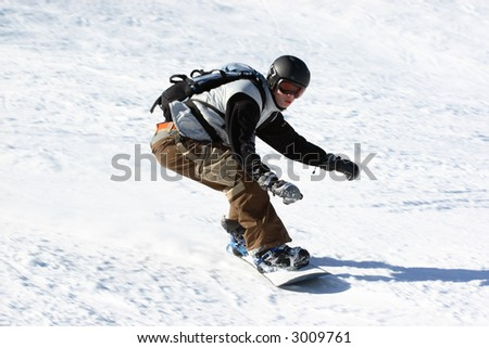 snowboarder slide down on hill - stock photo