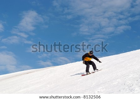 Snowboarder splashing snow - stock photo