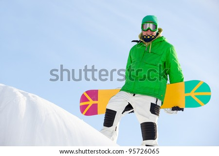 snowboarder standing on sky bakground - stock photo