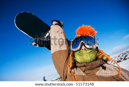 Snowboarder with snowboard portrait - stock photo