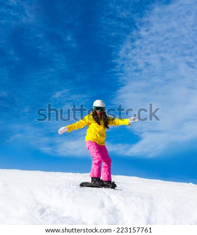 Snowboarder woman sliding down hill, snow mountains snowboarding on slopes