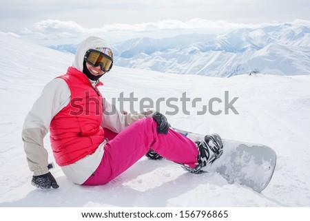 snowboarders is posing at camera at Gudauri resort in high mountaing of Georgia, Caucasus - stock photo