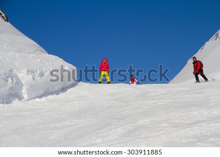 Snowboarders on the mountain slope, extreme sport - stock photo