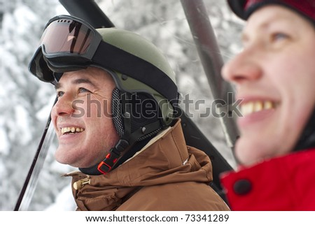 Snowboarders on the ski lift - stock photo