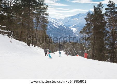 Snowboarders team goes through the forest road. Snowboarding Lifestyle adventure. People winter sports concept.