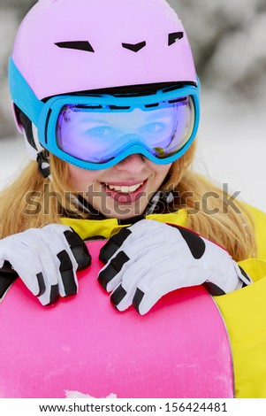 Snowboarding, Winter sports - portrait of young snowboarder girl