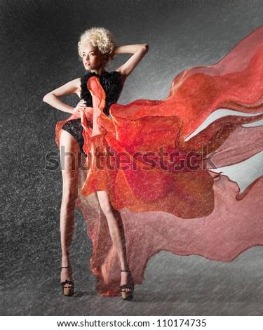 Snowbound girl in fluttering red skirt - stock photo