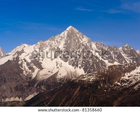 Snowbound mountain peak. French Alps over Chamonix valley, Mont Blanc massif, Aiguille Verte. - stock photo