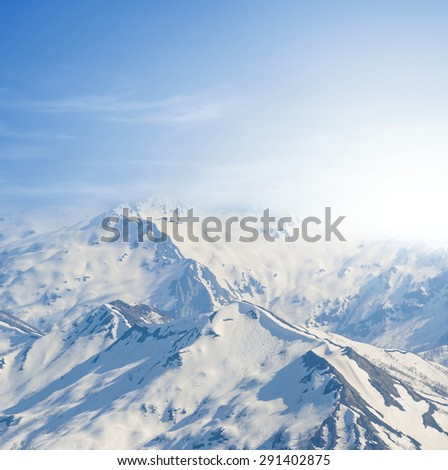 snowbound mountain peaks - stock photo