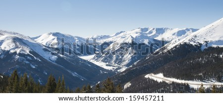 Snowcaped mountains in Berthoud Pass, Colorado. - stock photo
