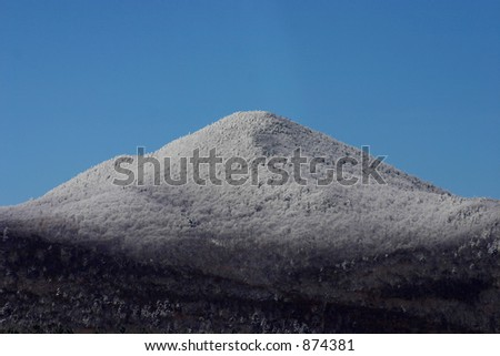 Snowcapped mountain peak in Vermont during winter. - stock photo