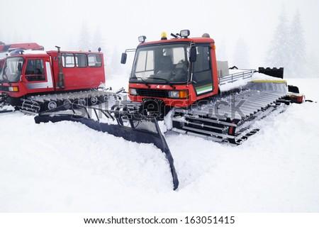 Snowcat on snow - stock photo