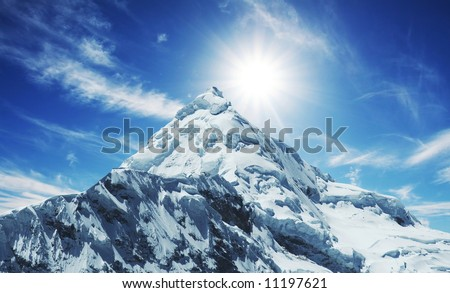 Snowcovered high mountain in Cordilleras - stock photo