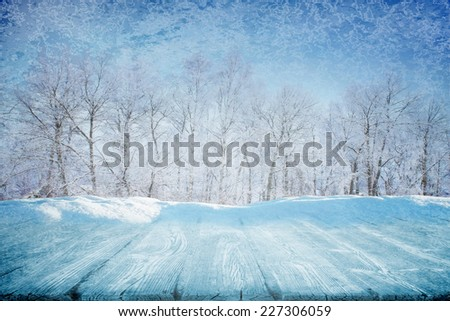 Snowdrift near frozen wooden path in winter sunny day - stock photo