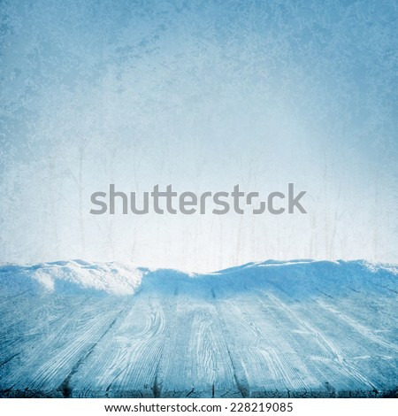 Snowdrift near frozen wooden path or picnic table in winter snowing day - stock photo