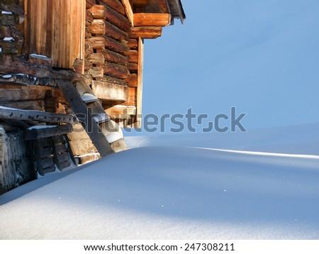 snowed mountain hut - stock photo
