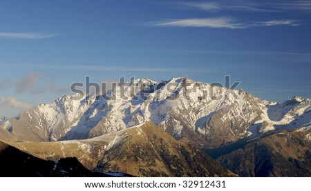 snowfall in the Pyrenees mountains at sunset