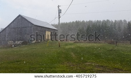 Snowfall on a barn property