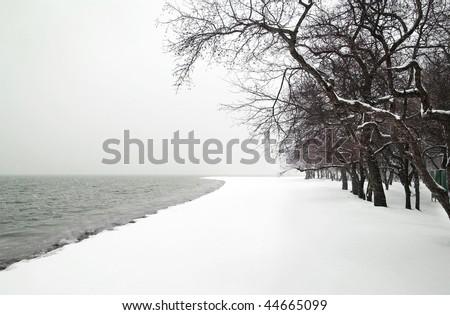 snowfall on the sea beach - stock photo